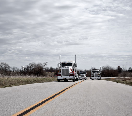 Kenworth W900L trucks on the road