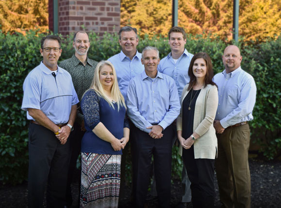 Jeff Johnson (front, center) received Kansas City Business Journal