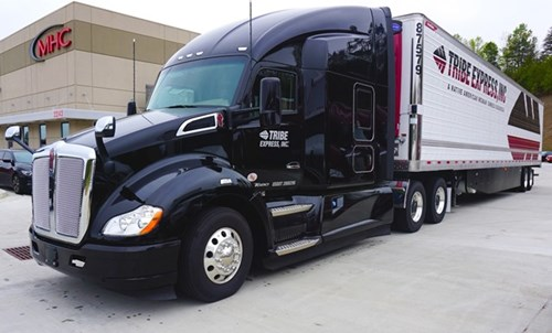 Tribe Transportation truck parked in front of MHC Kenworth - Gainesville